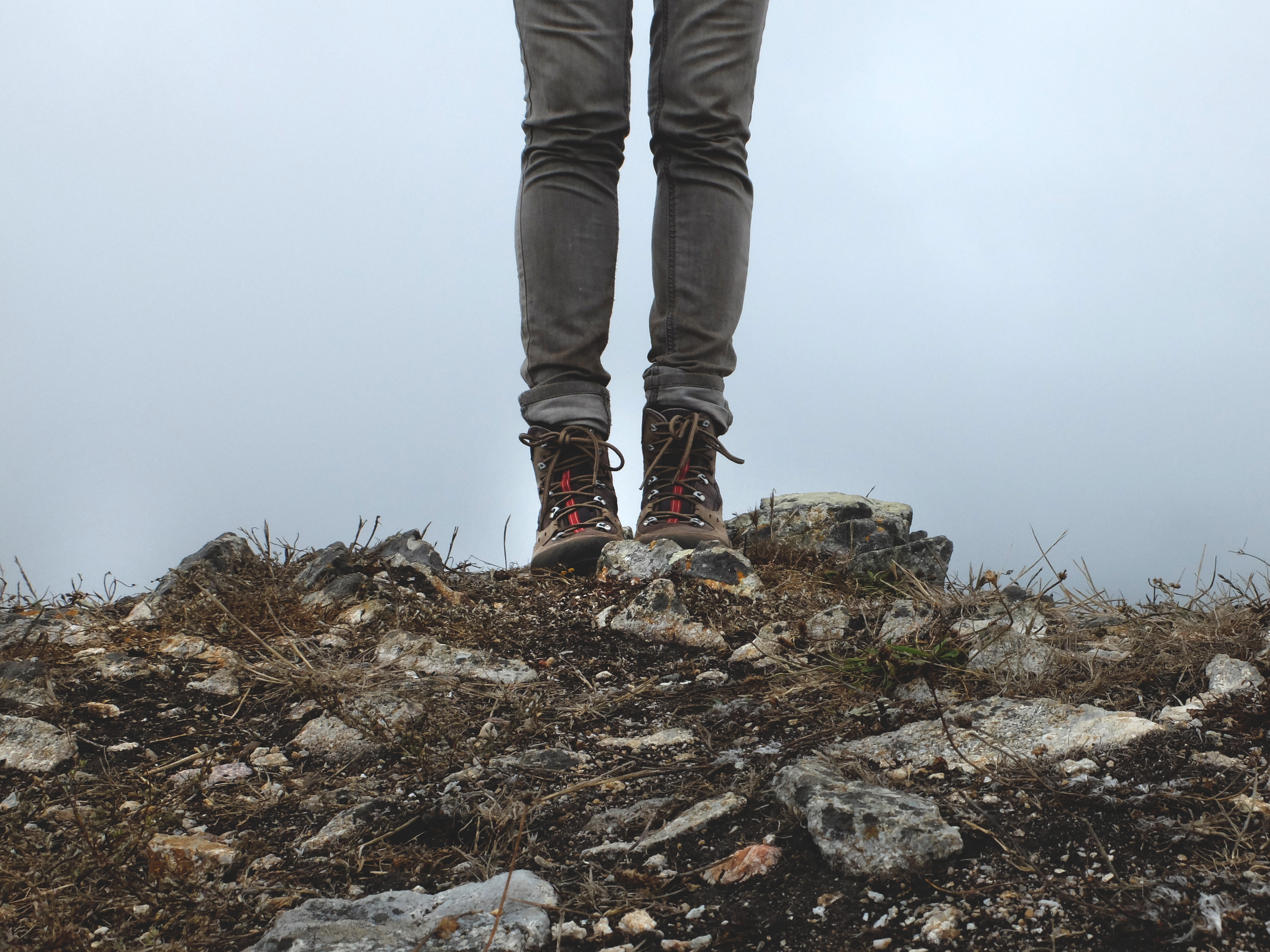 gray legs with hiking boots