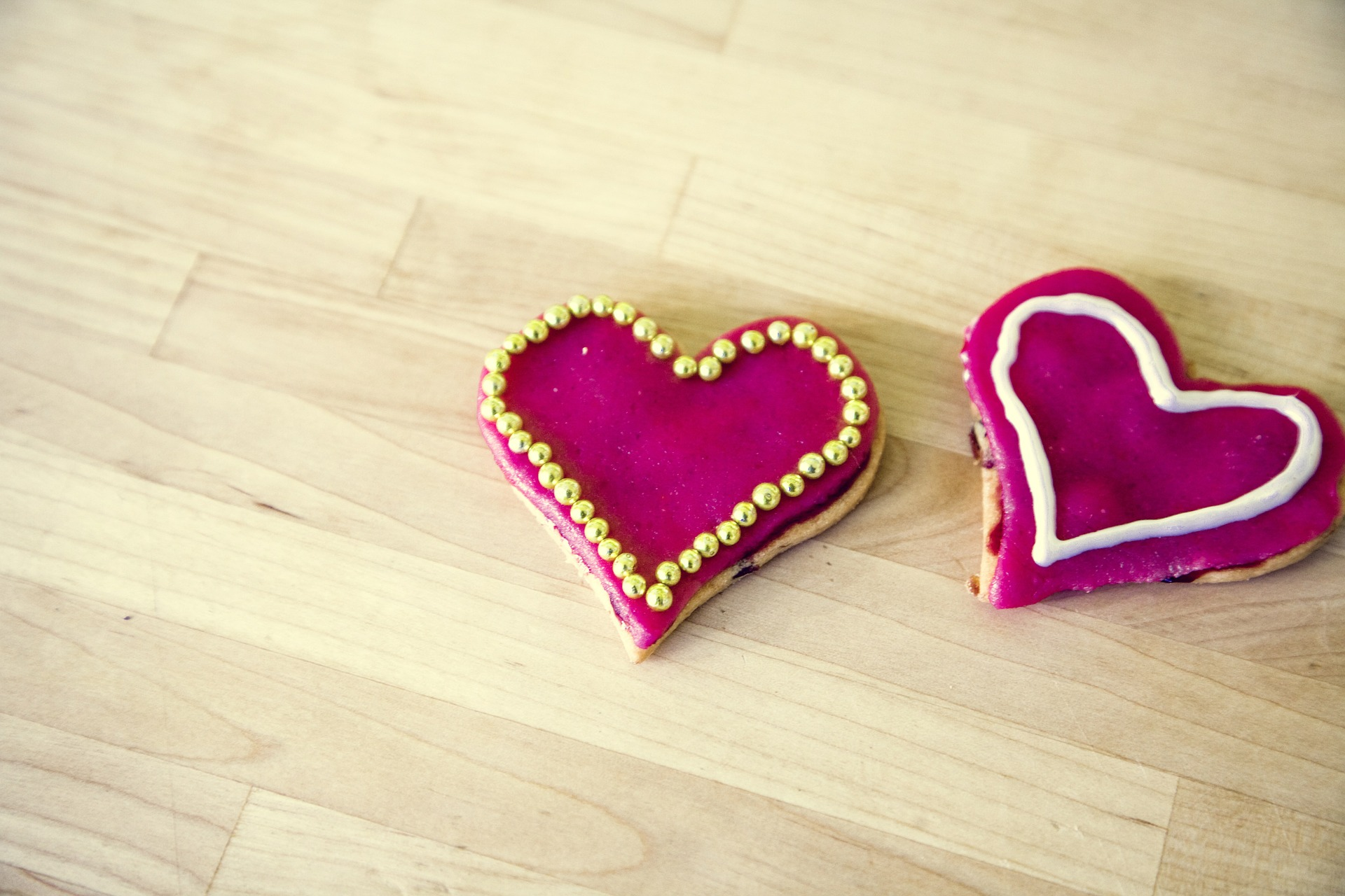 two heart cookies on wooden table